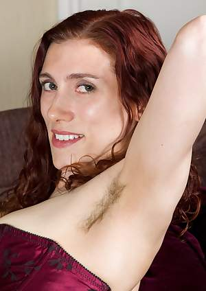 Hairy girl Amanda spreads her legs on her couch